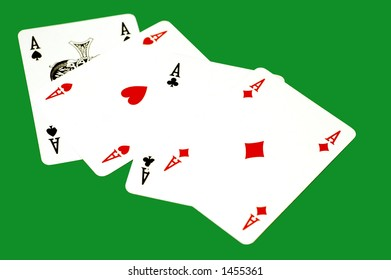 Four isolated aces on a deep green background