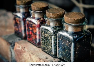 Four jars of different leaf teas