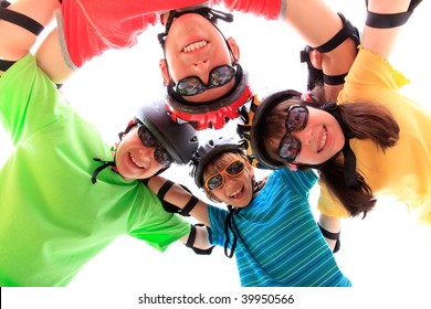 Four kids with helmets