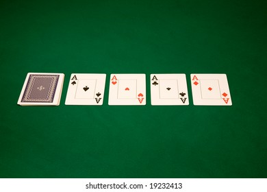 Four of a kind Aces in Las Vegas casino on the green table