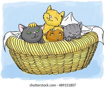 Four kittens in a wicker basket.