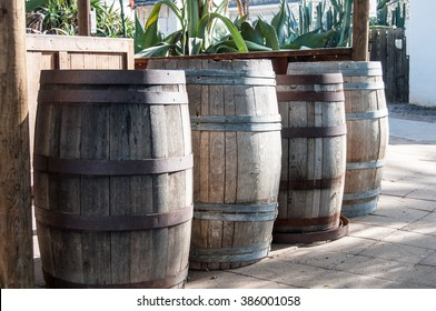 four large barrels standing on end