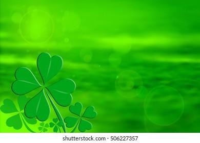 Four leaf clover design on a green background