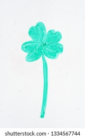 four leaf clover drawing on a whiteboard with green dry erase marker
