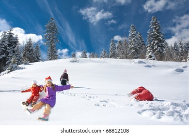 four little girls playing on the snow