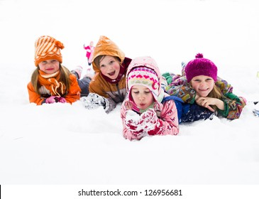 Four little kids playing in snow