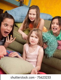 Four little outraged girls at a sleepover