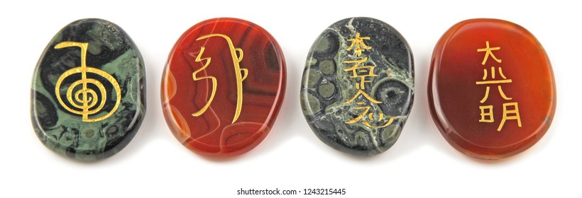 The four Major Reiki Symbols etched into Carnelian and Jasper stones, their meanings are: Sei he ki - harmony, Cho ku rei - power, Hon sha ze sho nen - distance, Dai ko myo - master