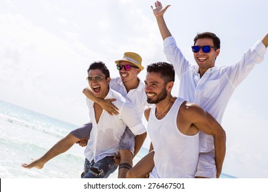 Four male friends at the beach