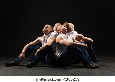 Four are man stay together isolated black background