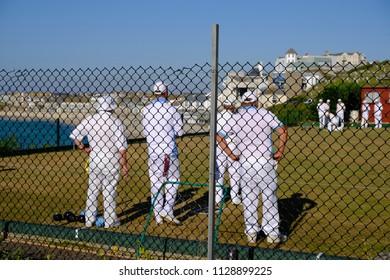 four man in white
