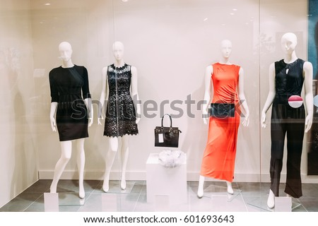 d07389f19a7 Four Mannequins Standing In Store Window Display Of Women s Casual Clothing  Shop In Shopping Mall.
