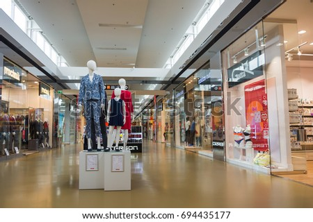 6bed9ef45fa93c Four mannequins with trendy clothes in the middle of the Factory Outlet  shopping mall on August