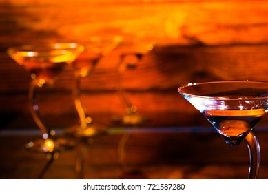 Four martini glasses on an elegant background with copy space.