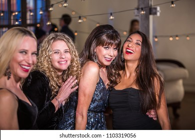 Four mature women having fun at a party