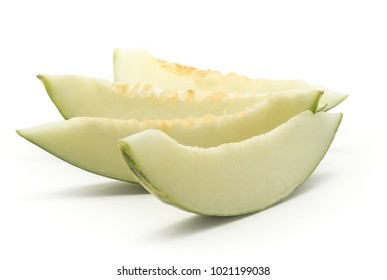 Four melon Piel de Sapo slices fan (Santa Claus Christmas variety) isolated on white background green striped outer rind without seeds