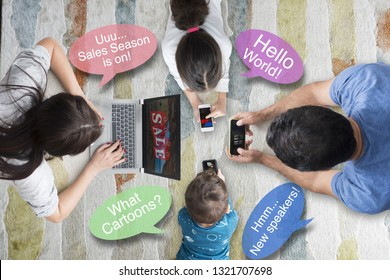 Four members family, with different interests, browsing mobile devices on carpet,