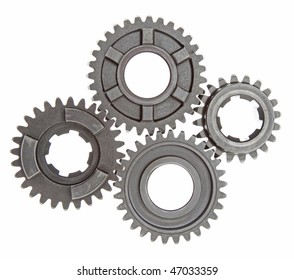 Four metal gears linked together on a white background.