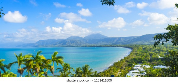 Four Mile Beach in Port Douglas in Tropical North Queensland with blue water