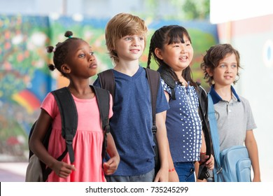 Four mixed race friends at elementary school.