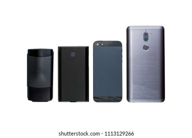 Four mobile phones of different times (from a buttoned mobile phone to a smartphone) on an isolated white background.