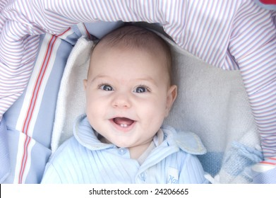 Four month baby - boy smiling and showing his two teeth