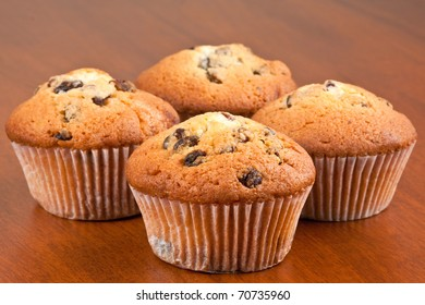 Four muffins on the table