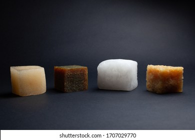four multi-colored cubes synthetic rubber samples on a black background shot close in the studio