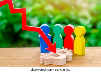 Four multi-colored figures of people surround a bitcoin figure struck by a red arrow. Conceptual decline in the cost of leading cryptocurrency and reducing capitalization. Big glitch. Selective focus