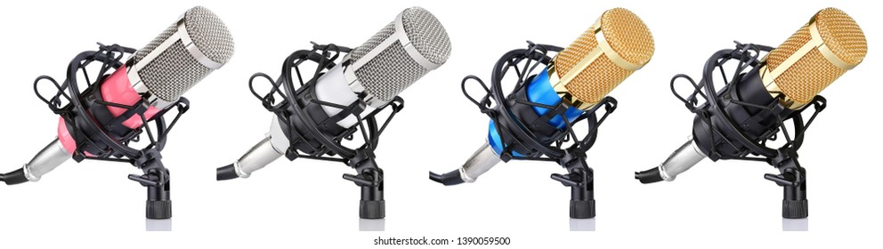 four multicolored microphones with holder on white background