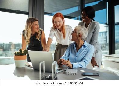 Four multinational businesswoman having a meeting