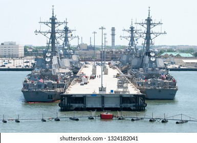 Four navy ships moored in a military base outside Norfolk town (West Virginia).