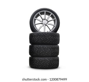 Four new good-looking snow tires isolated on the white background. A set of studded winter car tires. A set of wheels and tyre packages. Wheel parts. tire service