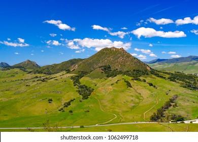 Four of nine sister peaks in the Morros of San Luis Obispo County, Bishop peak, Chumash peak, Cerro Romauldo, Hollister Peak, CA