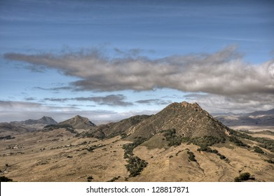 Four of the nine sister peaks in the Morros of San Luis Obispo County under an autumn sky.