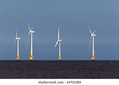 Four Offshore wind turbines in the North Sea.