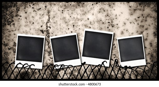 four old  instant photo frames stuck to a fence