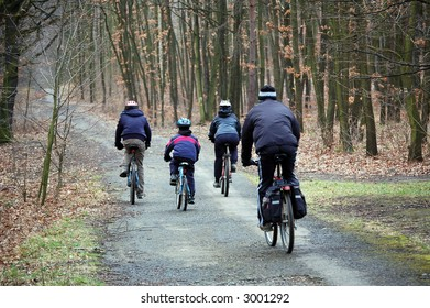 Four on bicycle