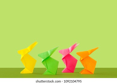 Four origami on green background