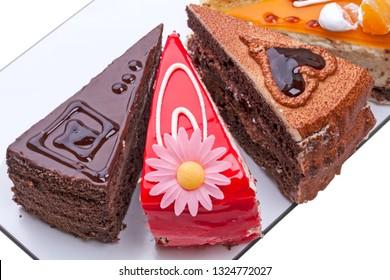 Four original cake pieces. Top view close-up