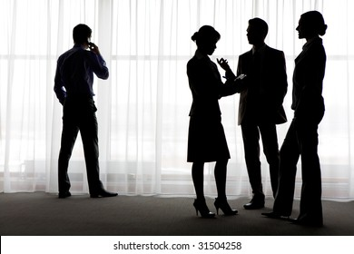 Four outlines of business partners communicating with calling male near by