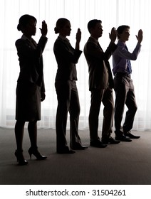 Four outlines of business partners standing in line with their hands raised