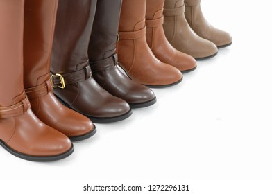 Four pair of female leather boots isolated on white background