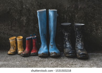 four pairs of muddy rain boots