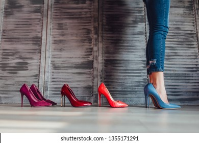 Four pairs pf heels isolated on grey studio! Fashion concept!