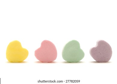 Four pastel candy  hearts against white
