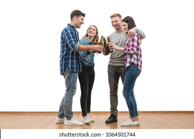 The four people drink a beer on a white wall background