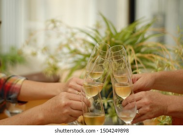 Four people drinking mead and giving toast.