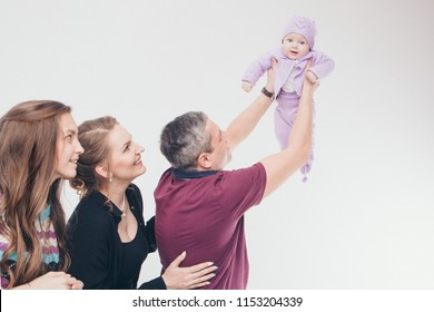 four people lined up on a white background. Business development concept: from small to large