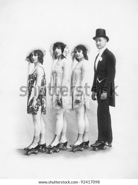 Four people on roller-skates standing in a line